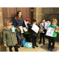 Year 1 Delivering the harvest food to St. John's Church