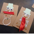 Printed snowmen with decoration stuck on