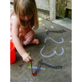 Trace chalk numbers with water and paint brush.
