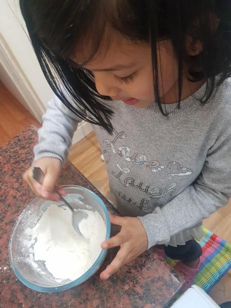 Inaaya mixing her pancake.