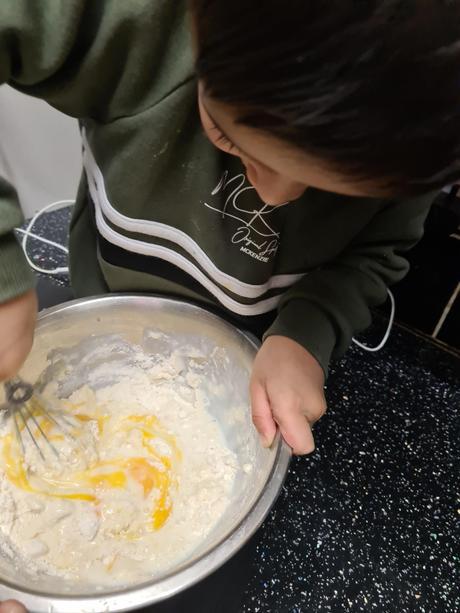 Yaseen making pancakes.