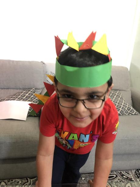 Zaryab made a dinosaur hat.