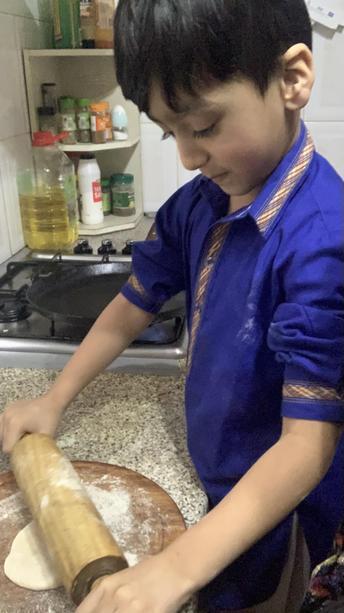Muhammad Turab making chapati.