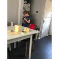 Emily measuring a room in her house