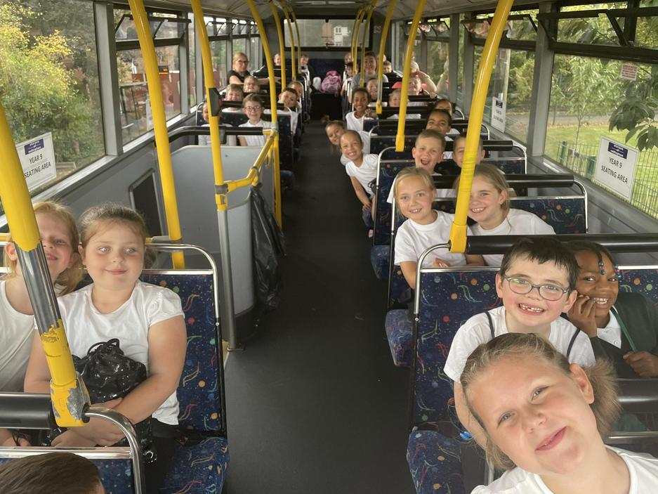 Getting excited on the bus for our first class swimming lesson.