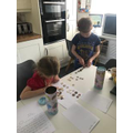 Emily and Sophie using adding skills to add money