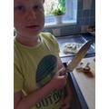 Finn chopping his veg into fractions