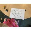 Drawing a happy sunshine
