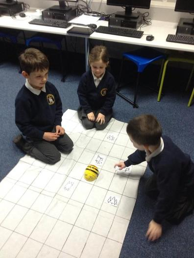 Working together to help the Bee-Bot find the treasure.