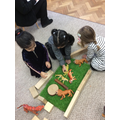 Playing cooperatively with small world animals