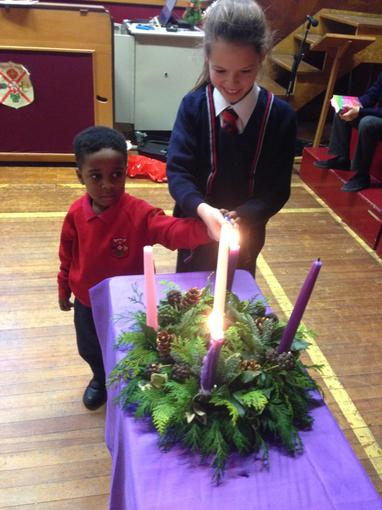Oldest & Youngest Lighting the Advent Candle