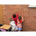 Using rain water to make marks and handprints