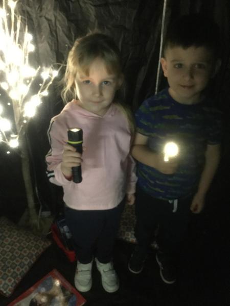 Inside the dark den with torches
