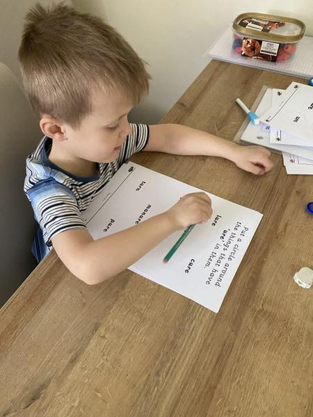 Alfie working very hard with his phonics!