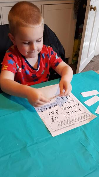 Isaac working hard with his bingo reads!