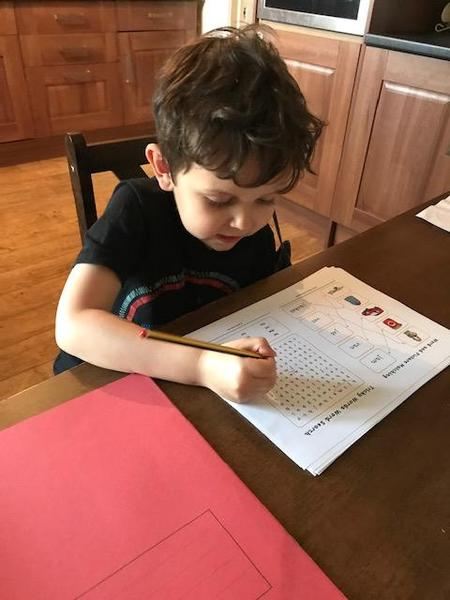 Tommy finding decodable words in his wordsearch