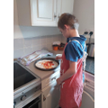 Harvey busy making his pizza