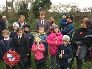 Children pay respects during Remembrance service