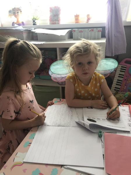 Oliwia working hard with her sister!