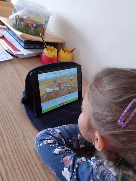 Hannah working reading on bug club!