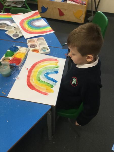 We made rainbows to display in our windows at home