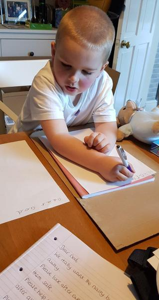 Isaac writing his lovely prayer!