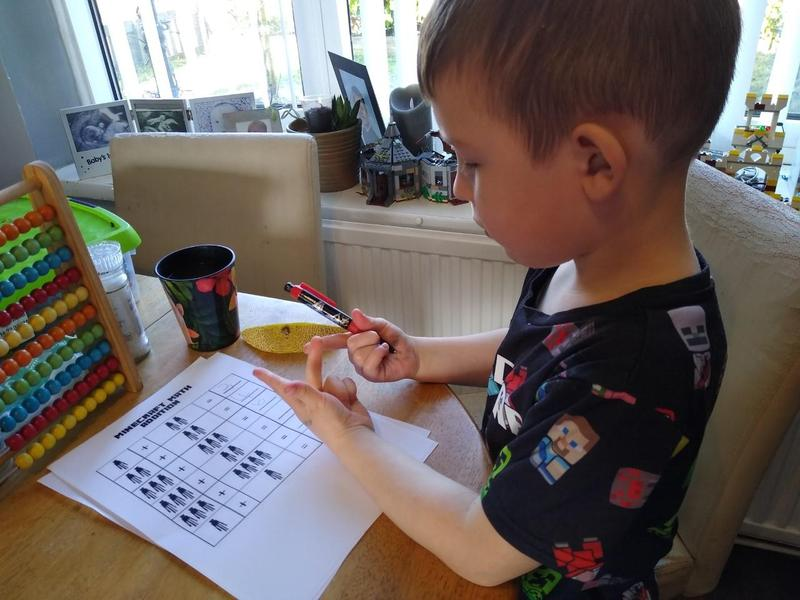 Jaxson concentrating, carefully counting