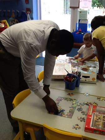 Odadiah working on a jigsaw.