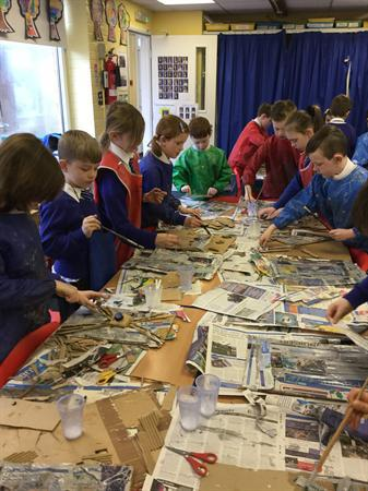 Papier mache fun - we're making our Roman shields!