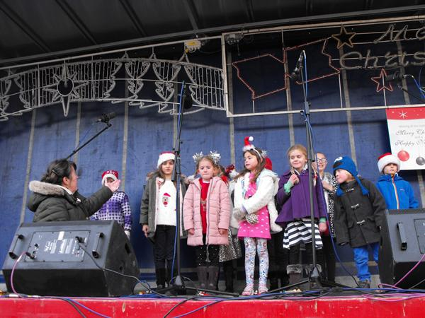 Singing Club at Lights switch on event in Burnham