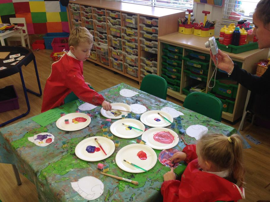 Mixing colours to paint Elmer.