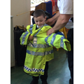 Trying on a police Hi-Vis jacket.
