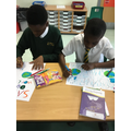 Children designed posters to teach people about the impact of global warming.