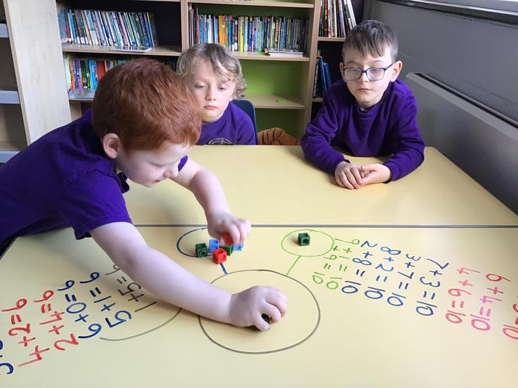 Some of our KS1 children working on their number bonds using manipulatives