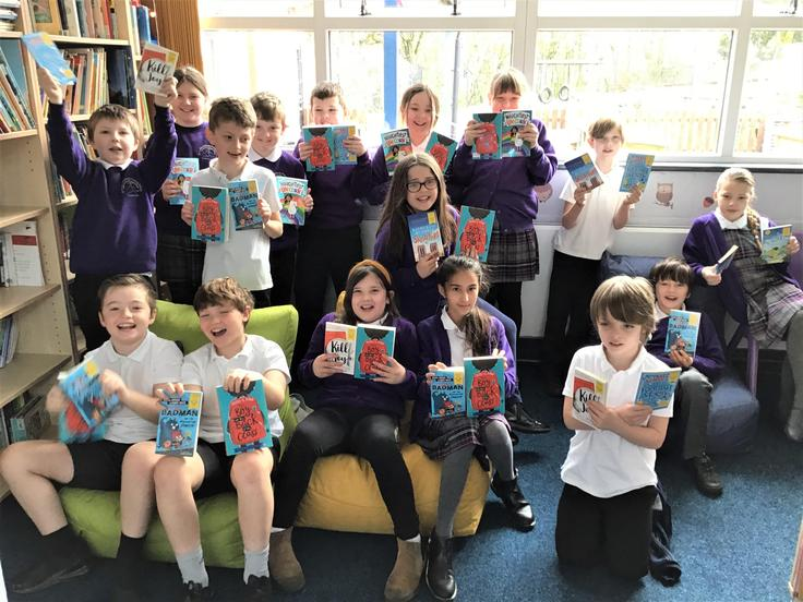 Delighted classmates with their free books!
