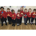 Super number formation by Nursery class on their badges