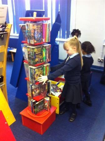 Kelsey choosing a book.