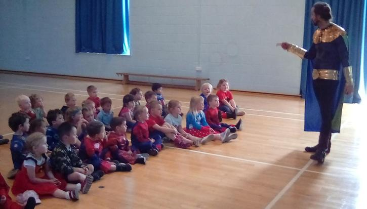 Our special superhero visitor teaching us all about superheros.