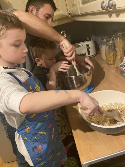 Measuring ingredients to make flapjacks