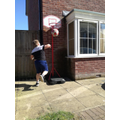 Taylon playing basketball
