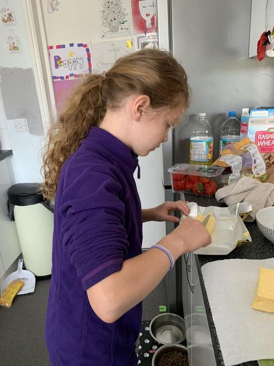Grace baking a cake