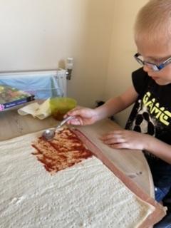 Roman making pizza