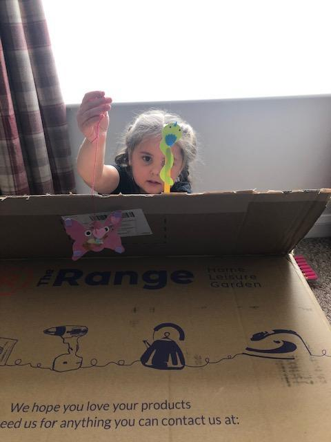 Daisy getting creative with a puppet show