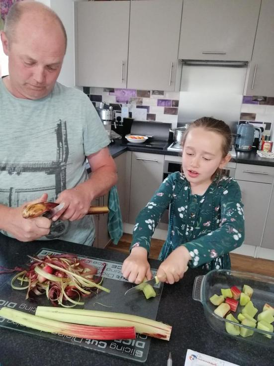 Emily and Dad baking rhubarb crumble