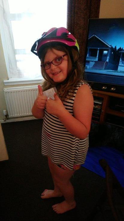 Poppy wearing her prize