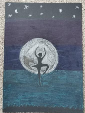 Tegan dancing in front of the moon