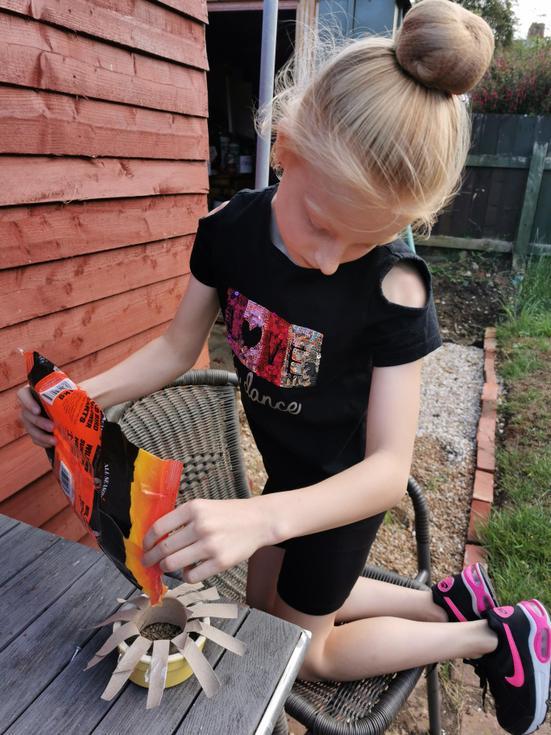 Tegan makes a bird feeder