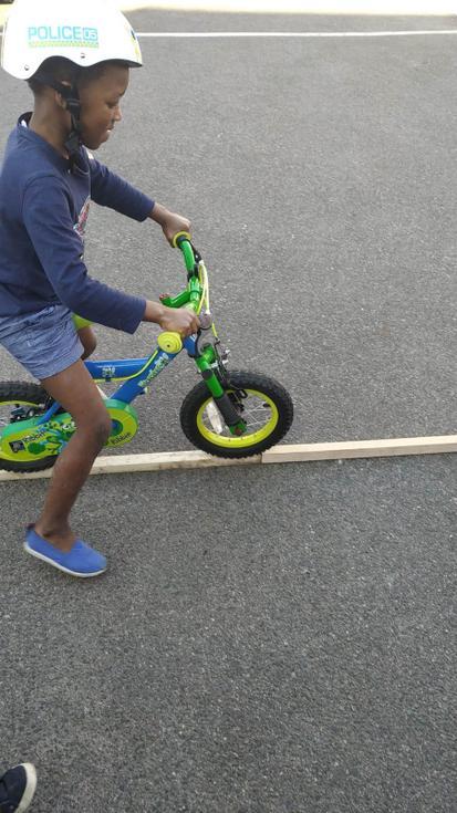 Praise having fun riding his bike
