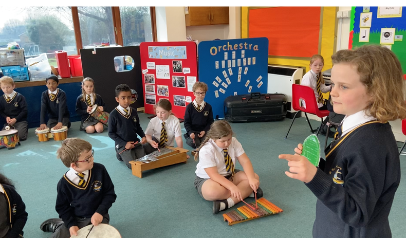 Year 3 pupil conducting soundscape