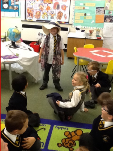 Trying on the items in our sensory bag!